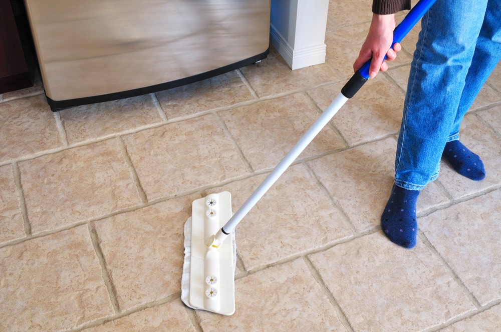 Cleaning natural stone tile floors with a mop